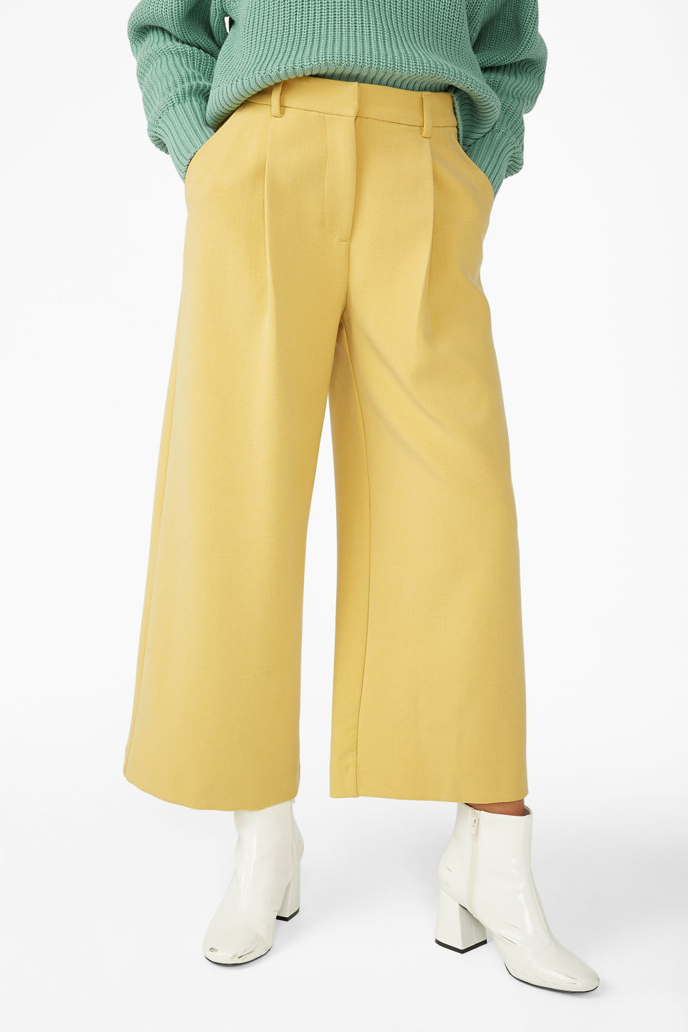 Model side image of Monki wide leg trousers in yellow