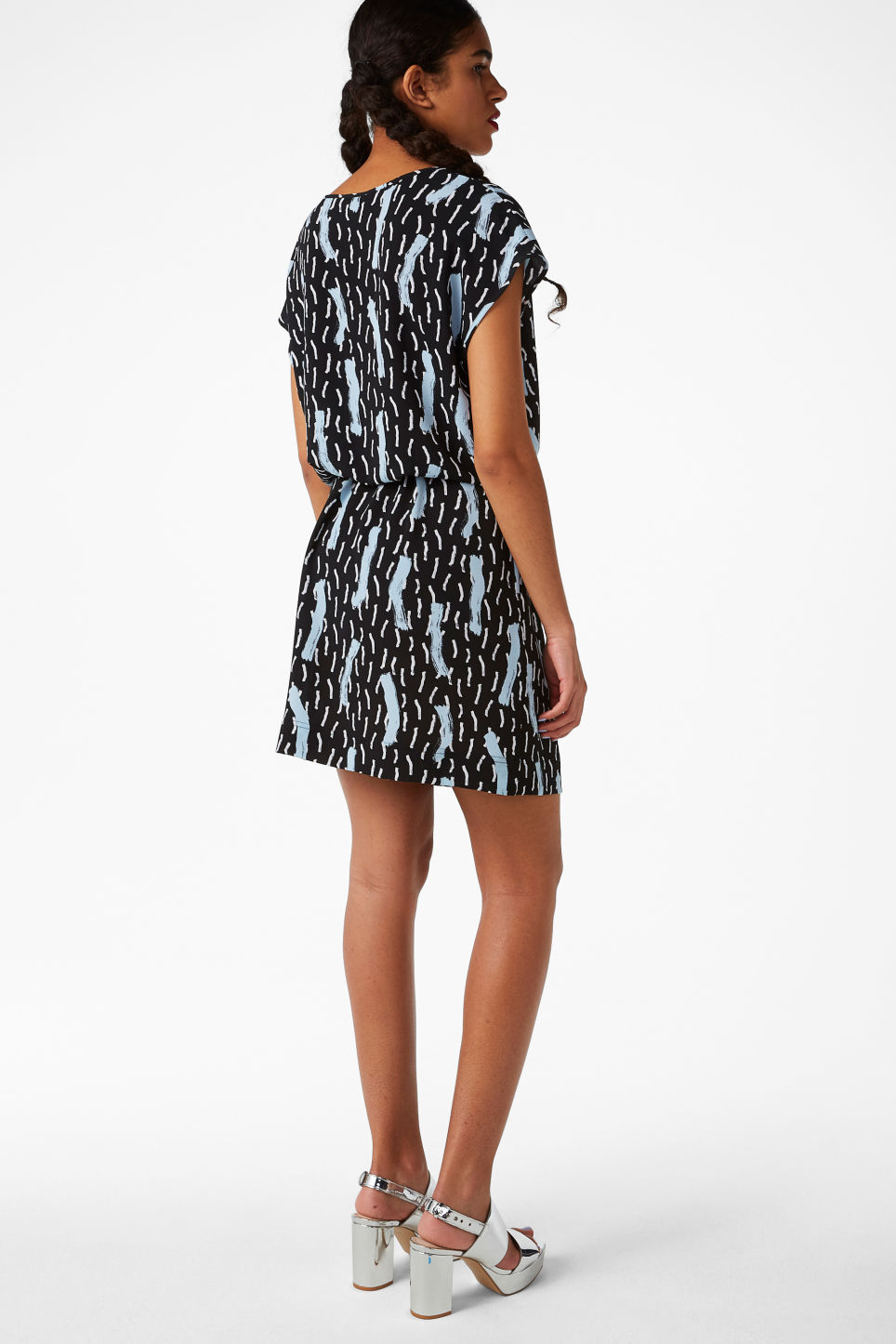 Model side image of Monki drawstring dress in black