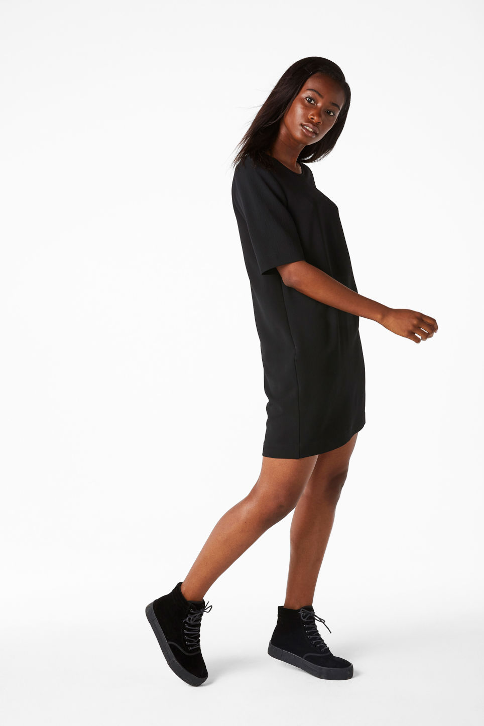 Model side image of Monki classic stretch dress in black