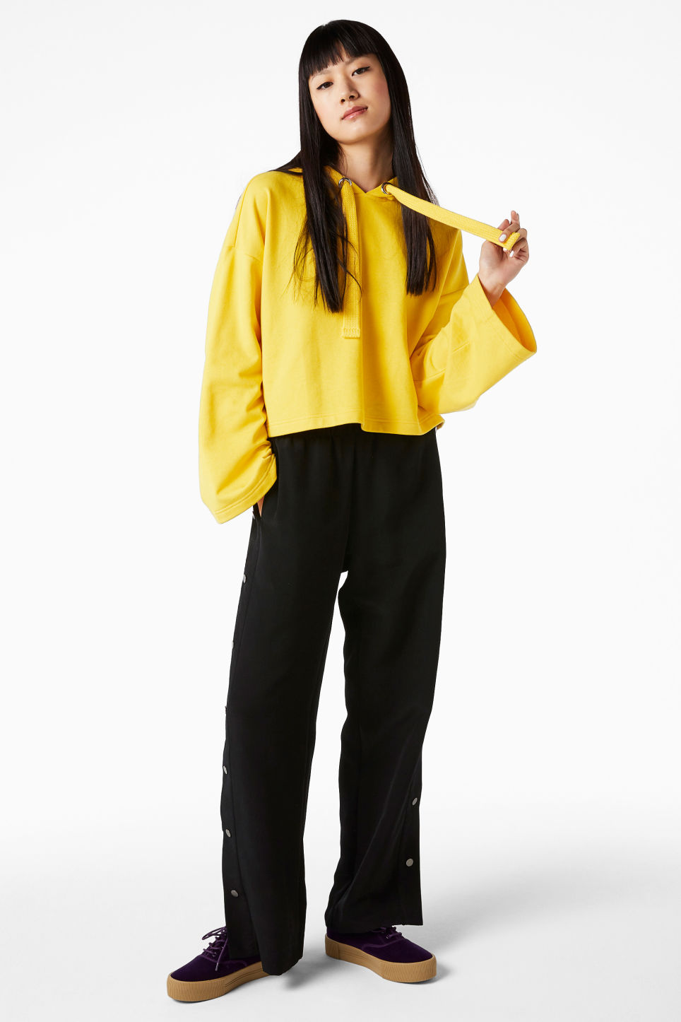 Model front image of Monki wide sleeve hoodie in yellow