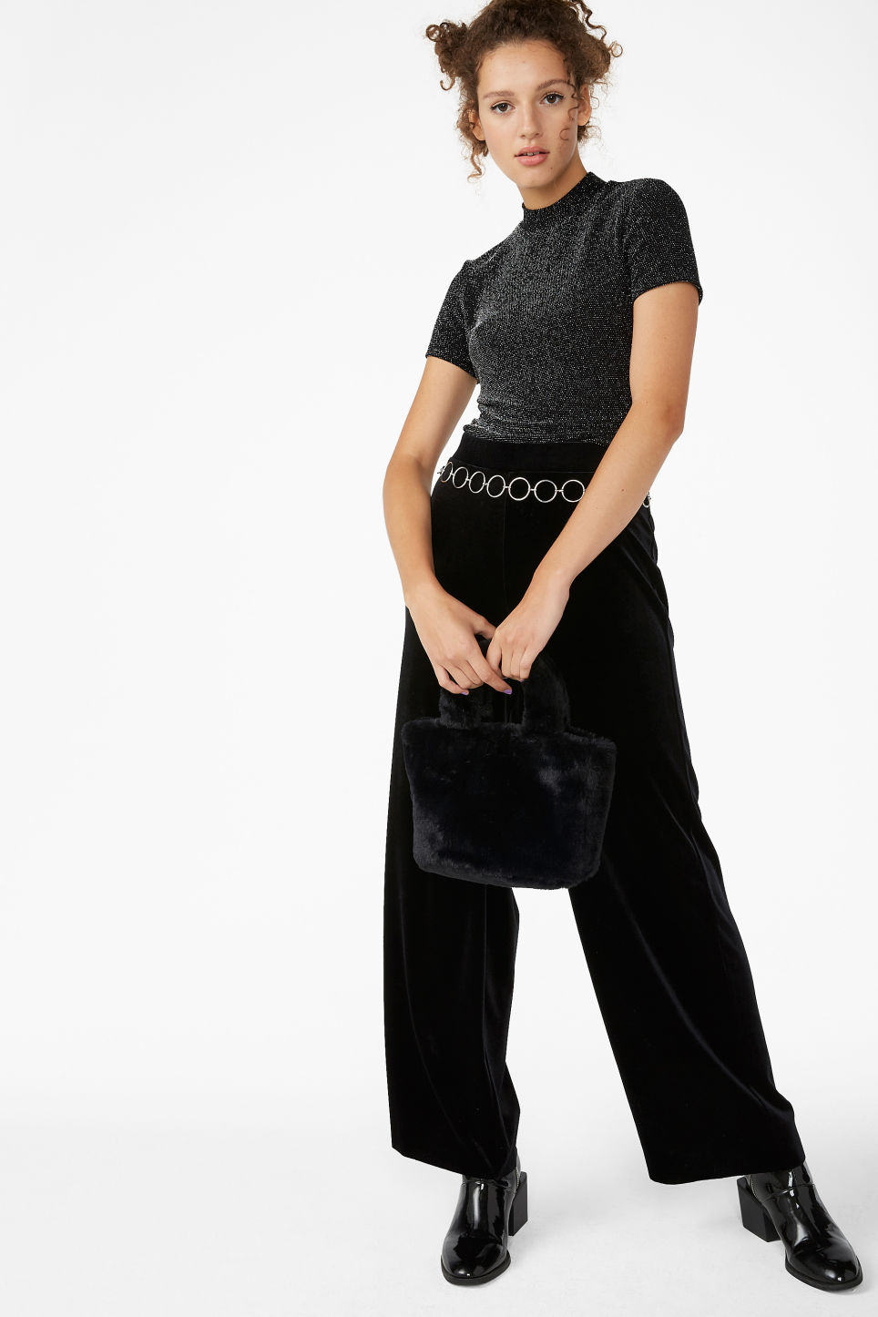 Model side image of Monki glittery turtleneck top in black