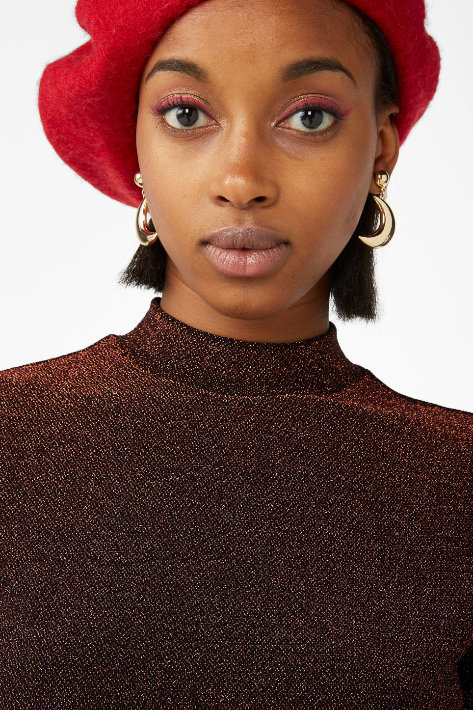 Model front image of Monki glittery turtleneck top in black