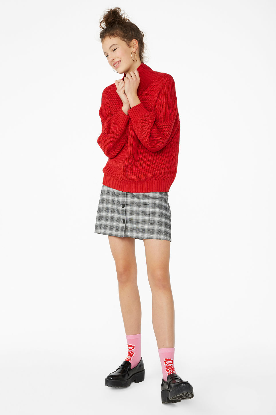 Model side image of Monki chunky knit sweater in red