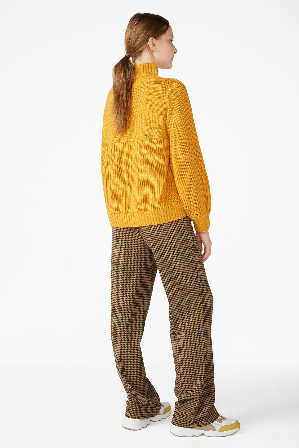 Model back image of Monki knit sweater in yellow
