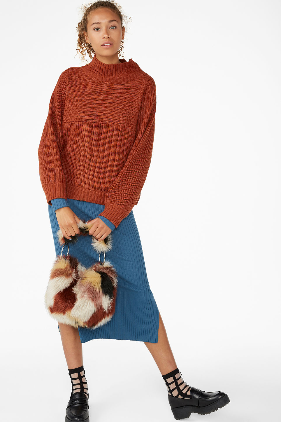 Model side image of Monki chunky knit sweater in orange