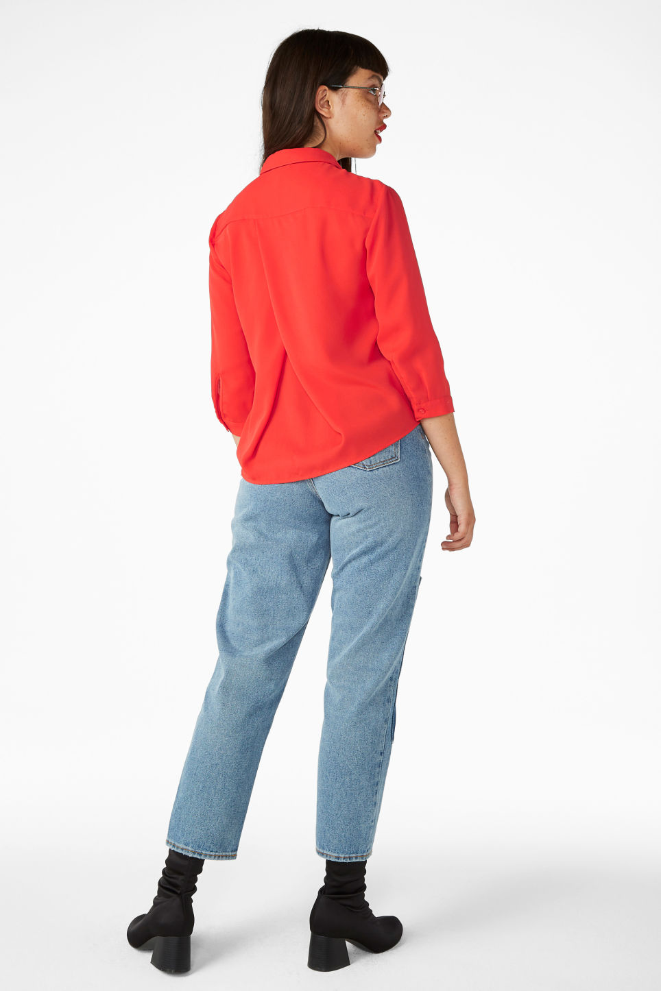 Model side image of Monki button up blouse in red