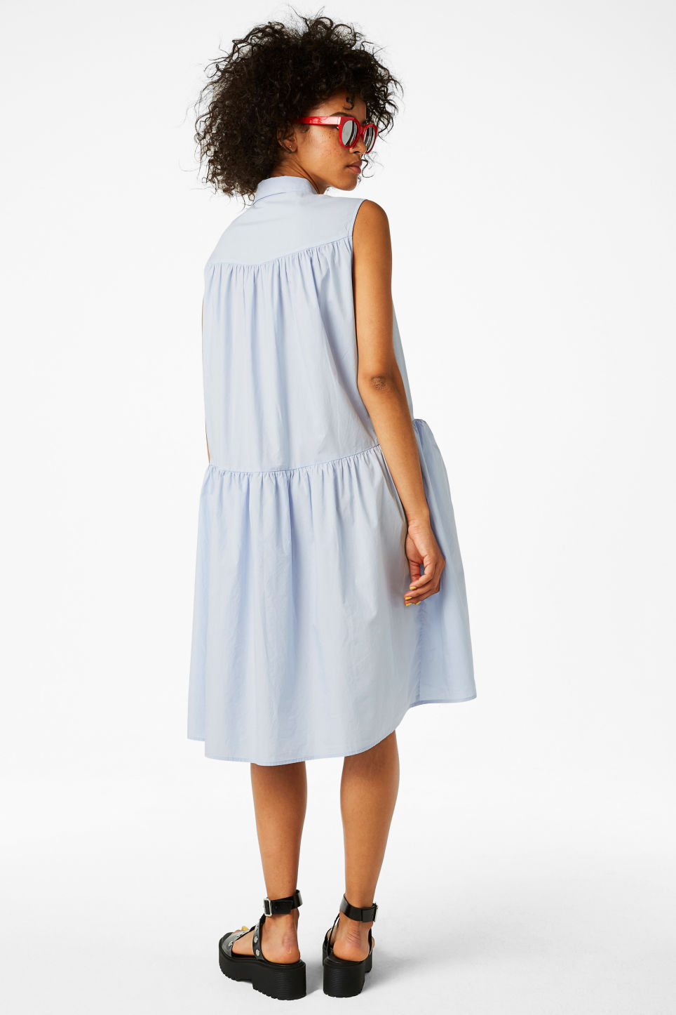 Model side image of Monki sleeveless dress in blue
