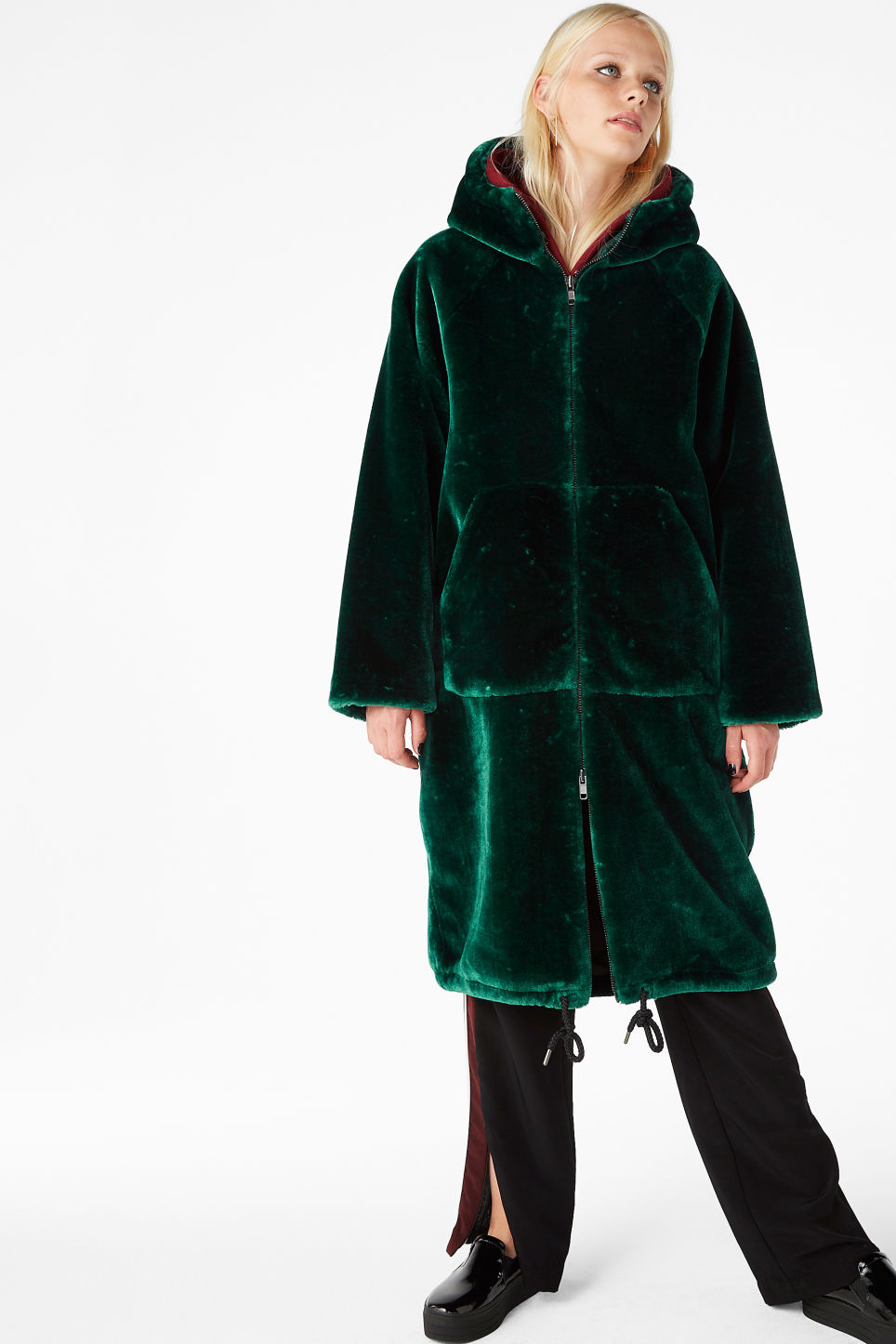 Model front image of Monki hooded faux fur coat in green