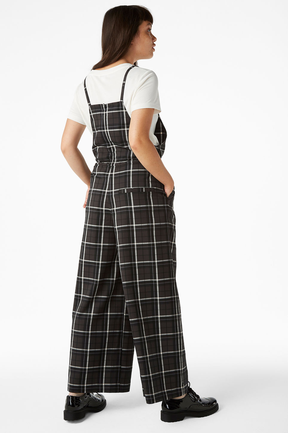 Model side image of Monki wide leg dungarees in grey