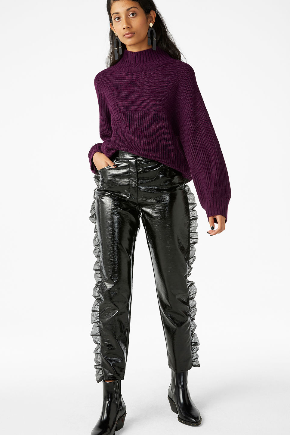 Model front image of Monki patent trousers in black