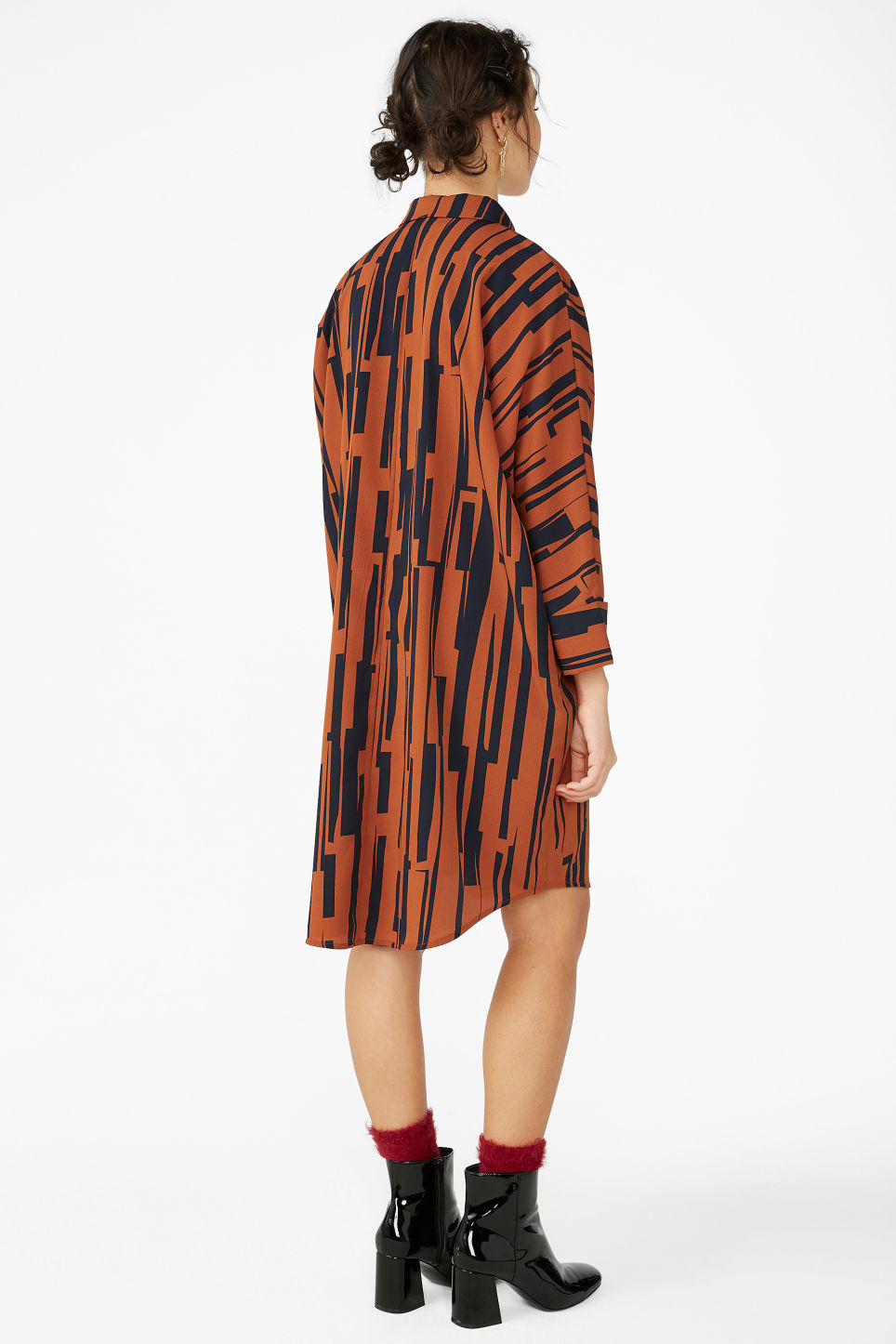 Model back image of Monki oversized shirt dress in orange