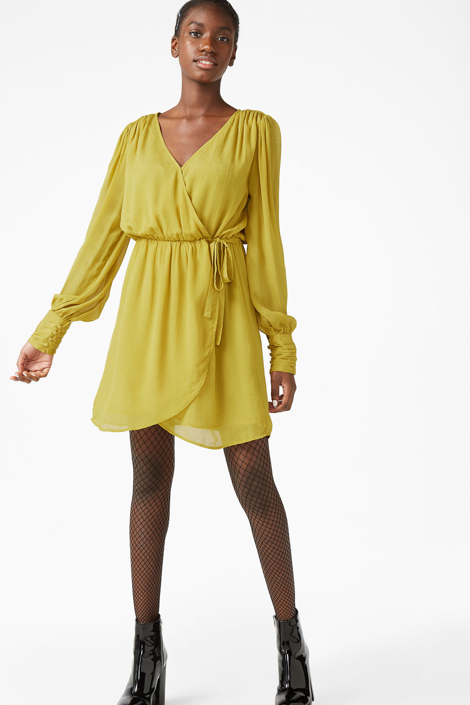 Model front image of Monki gold wrap dress in yellow