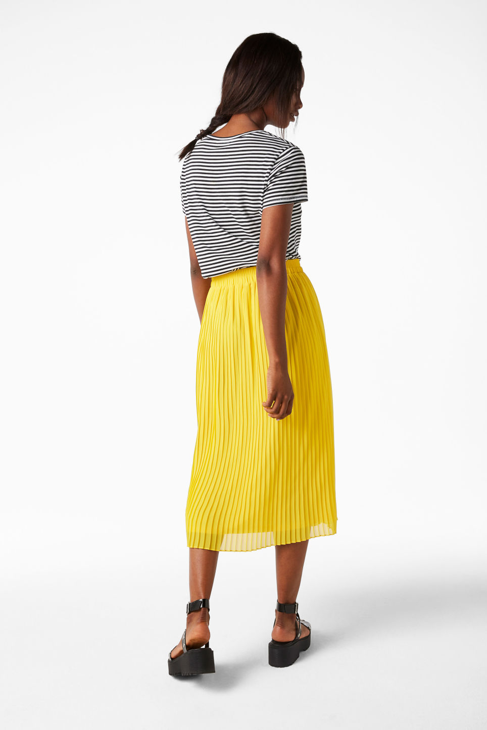 Model side image of Monki pleated midi skirt in yellow