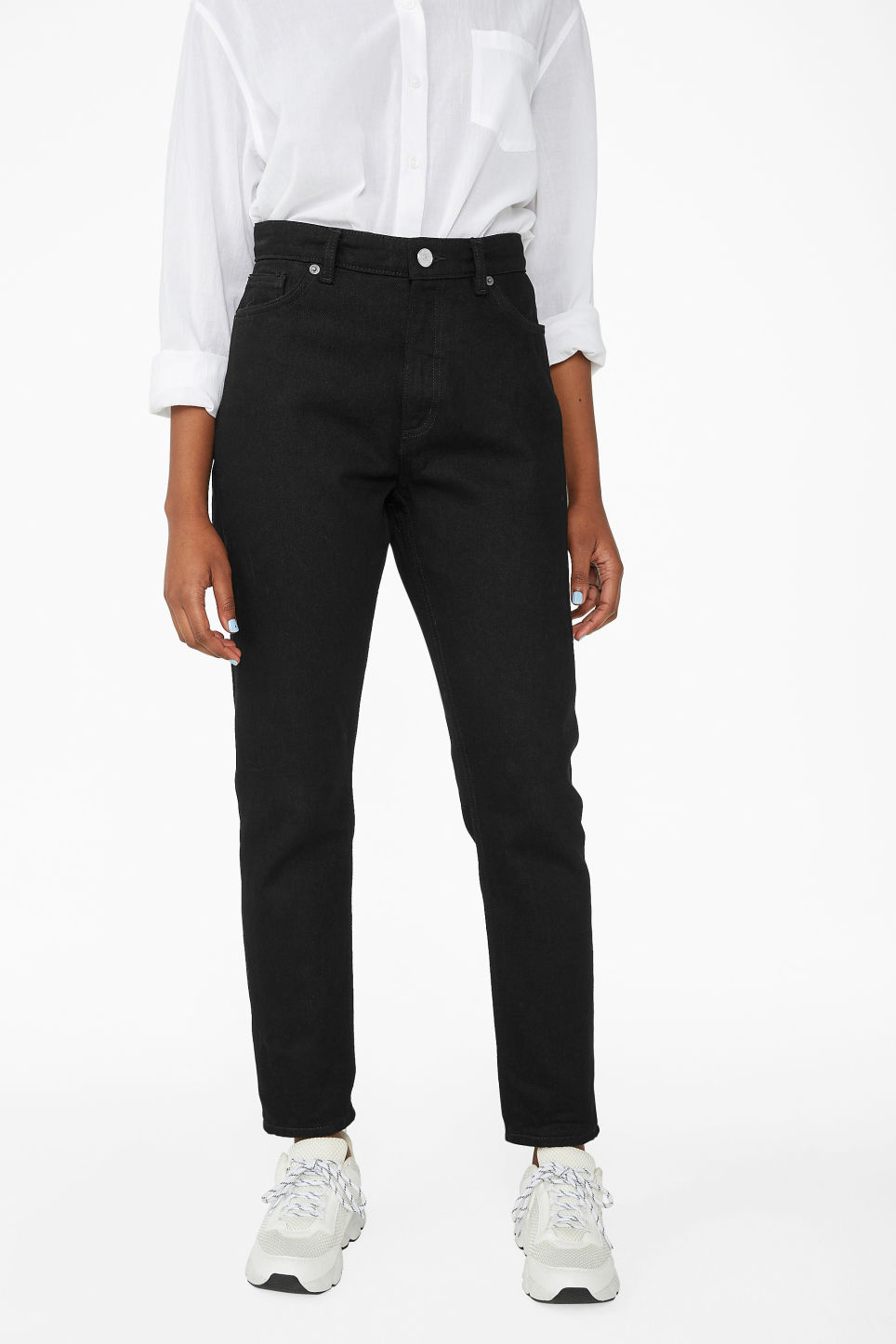 Model side image of Monki kimomo deep black jeans in black