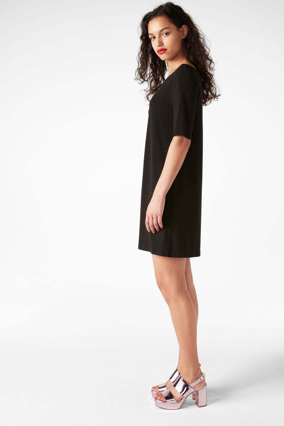 Model side image of Monki scoop neck dress in black