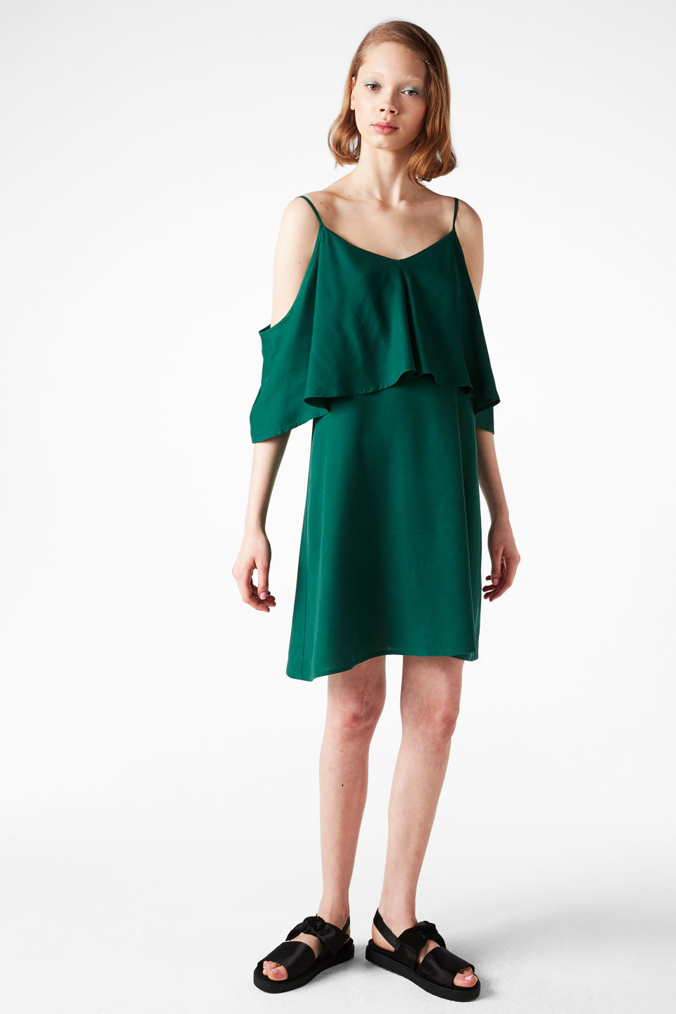Model front image of Monki cold shoulder ruffle dress in green