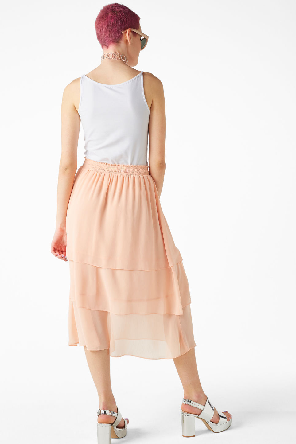 Model back image of Monki ruffle layered midi skirt in pink