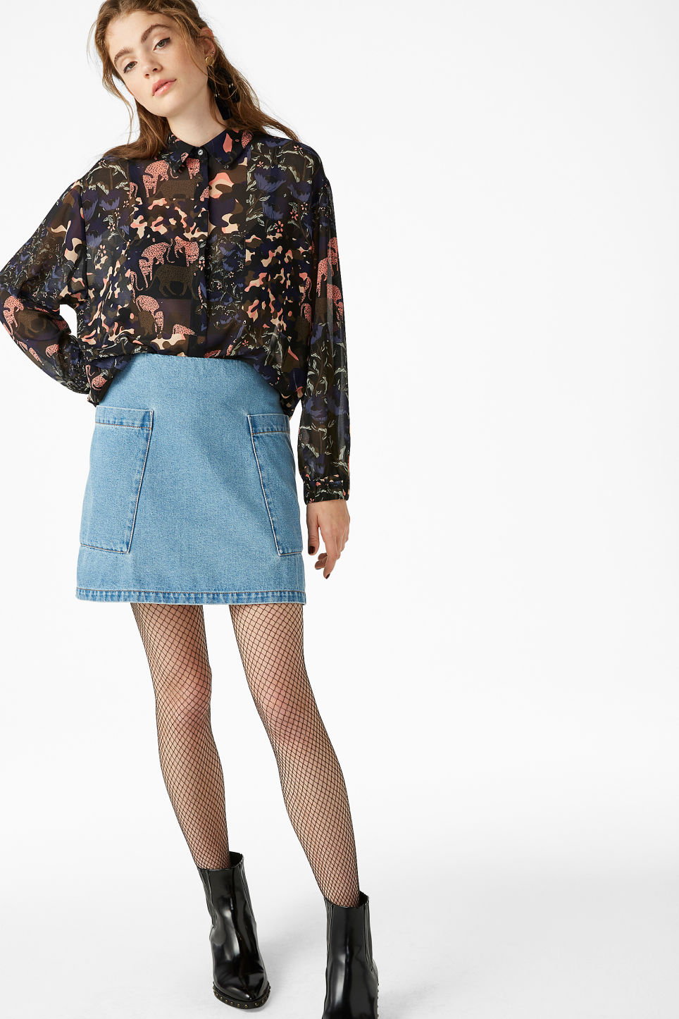 Model front image of Monki printed sheer blouse in black