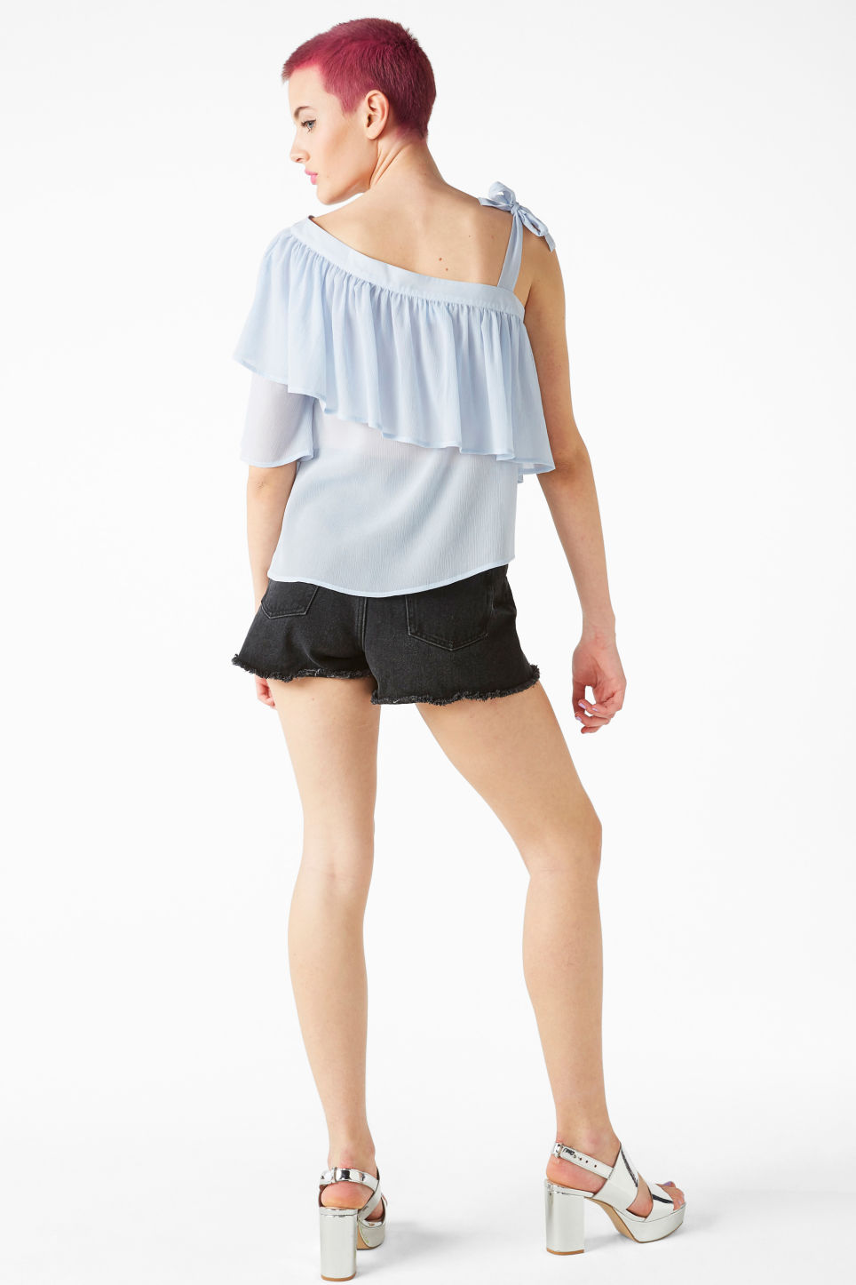 Model back image of Monki asymmetric ruffle shoulder top in blue