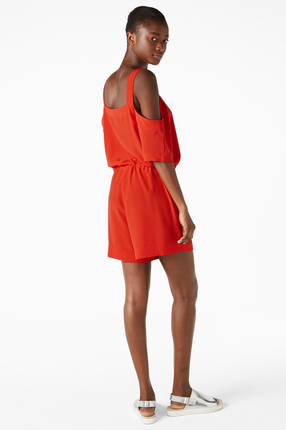 Model side image of Monki cold shoulder playsuit in red