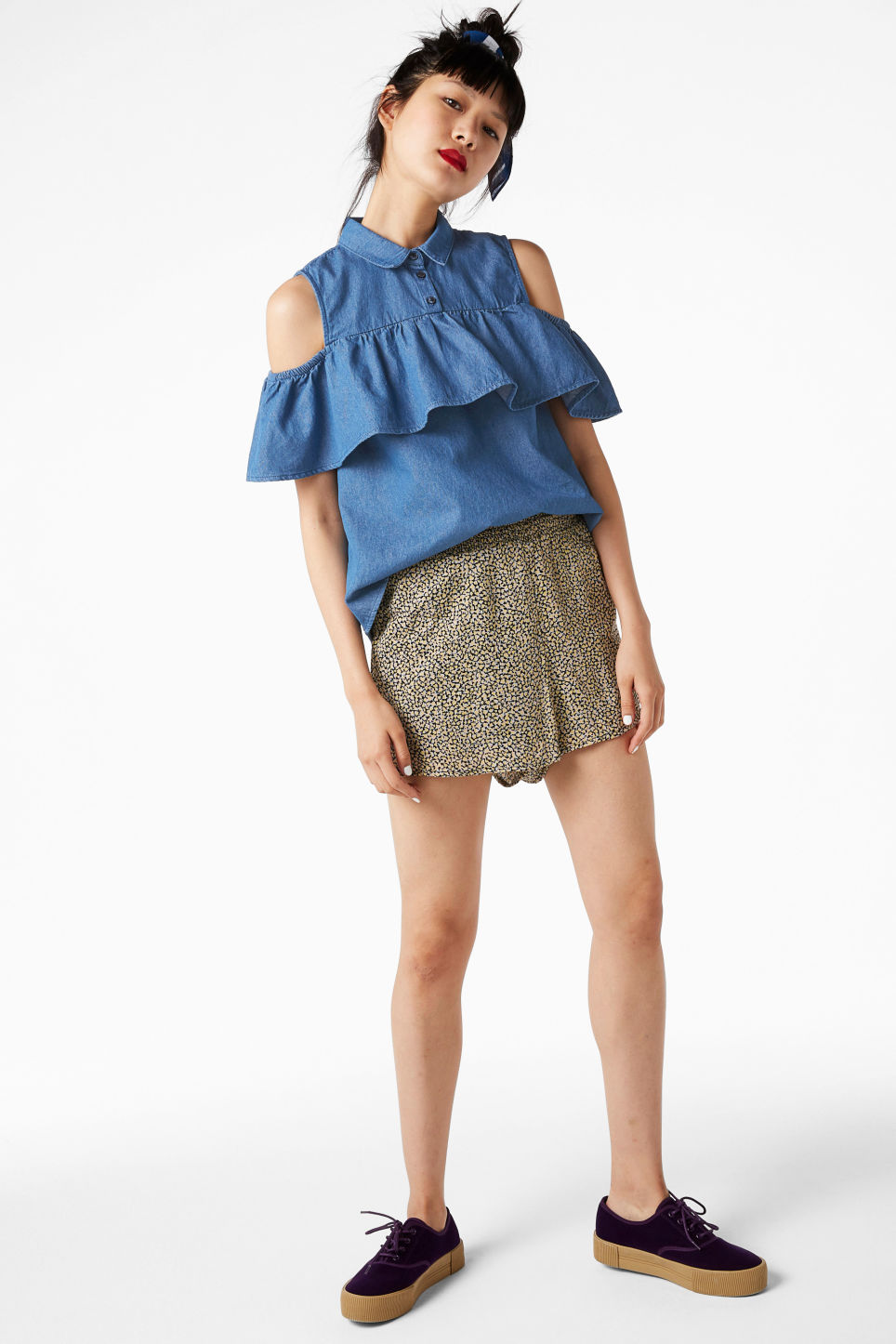Model front image of Monki cold shoulder ruffle blouse in blue