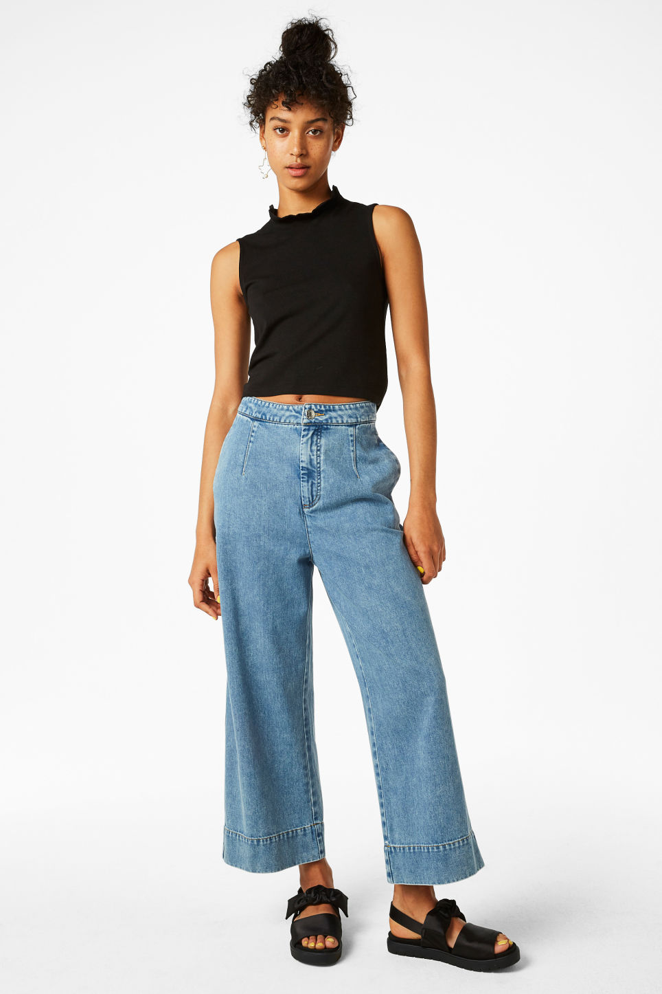 Model front image of Monki ruffle neck cropped top in black