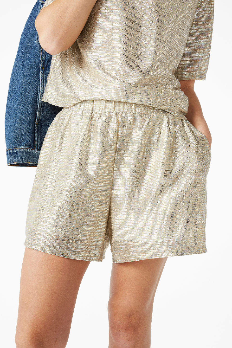 Model side image of Monki party shorts in silver