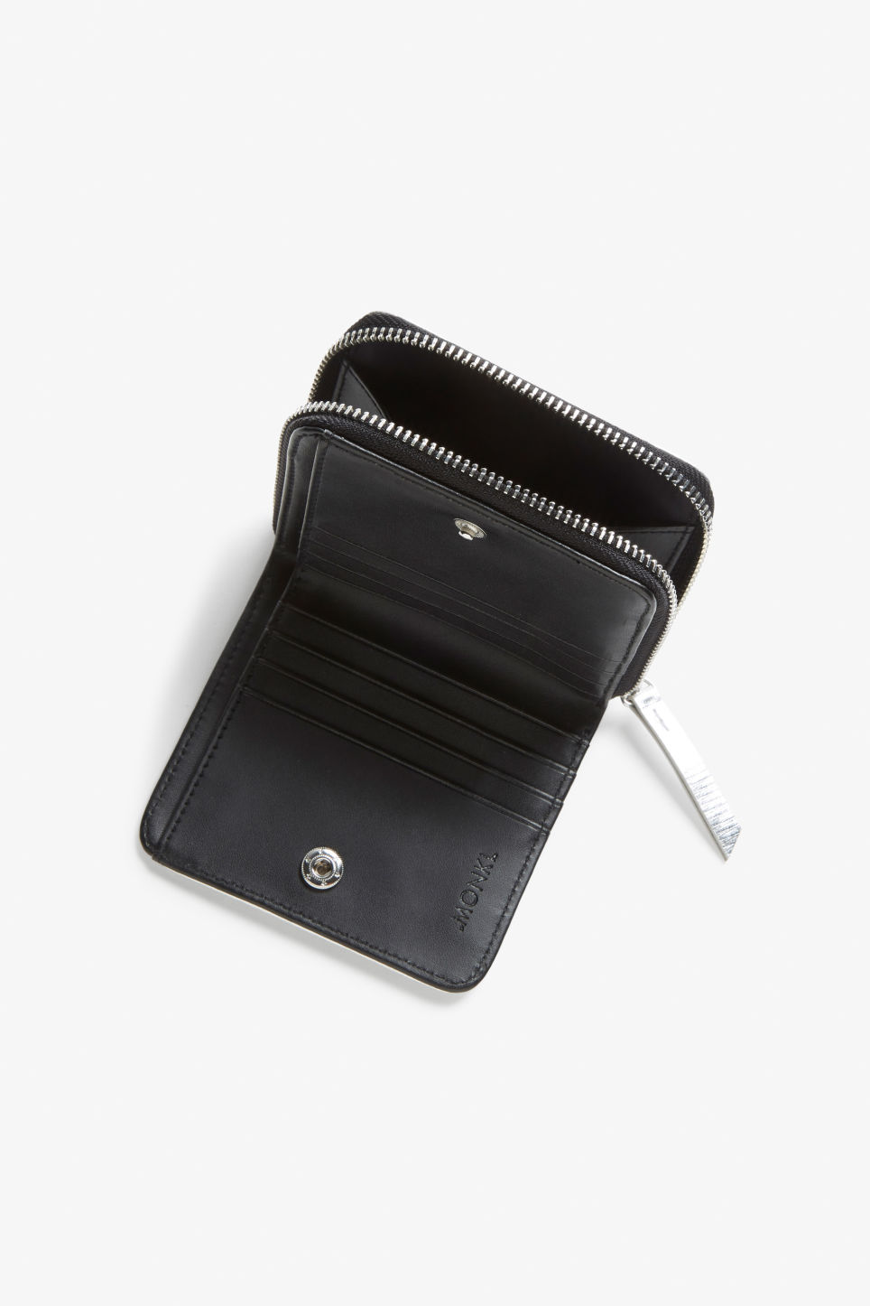 Model side image of Monki coin purse wallet in silver