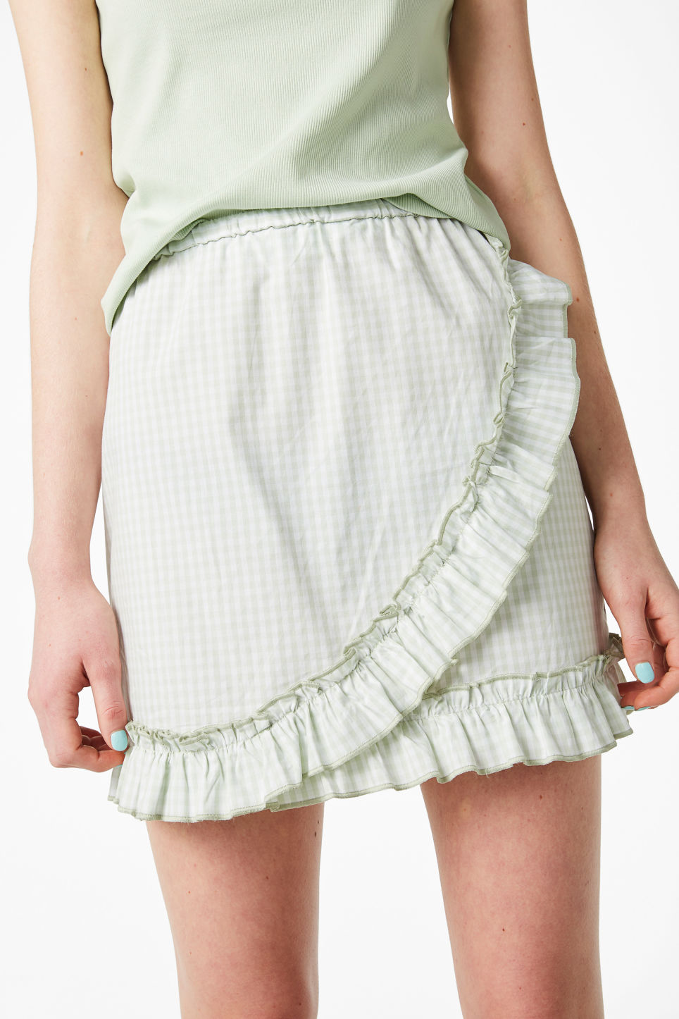 Model front image of Monki ruffle wrap skirt in green