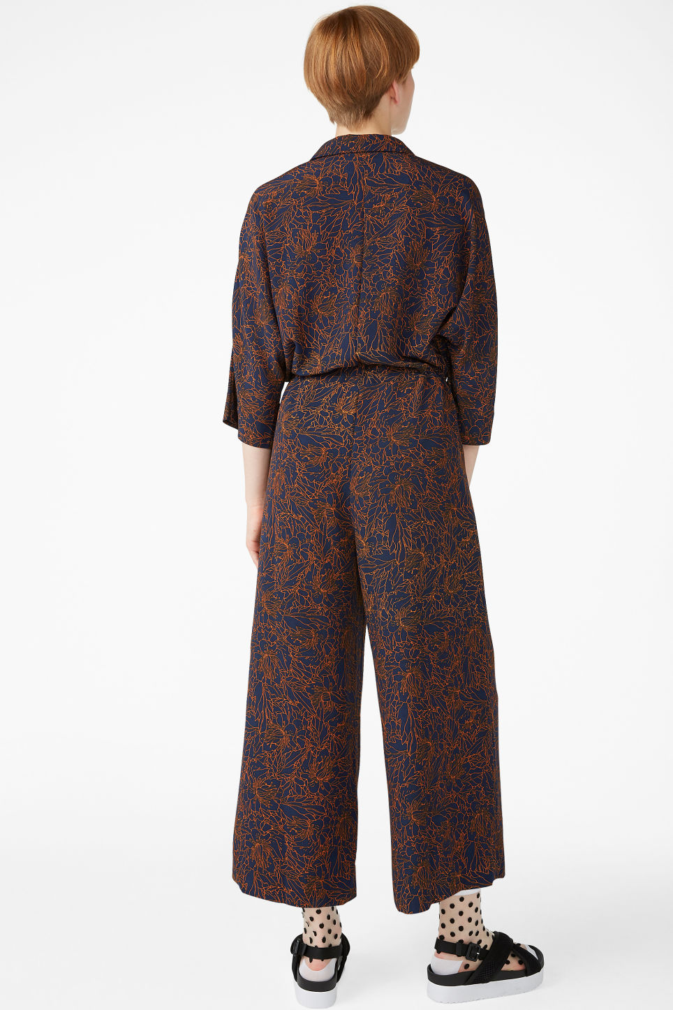 Model back image of Monki wide fitting jumpsuit  in blue
