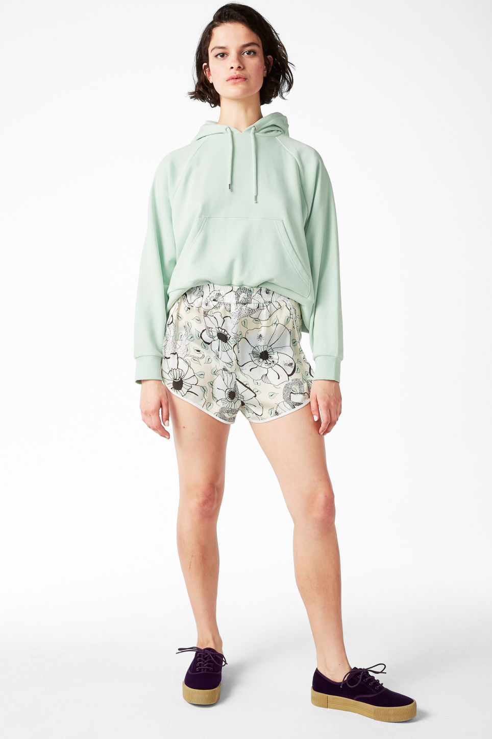 Model front image of Monki satin shorts in white