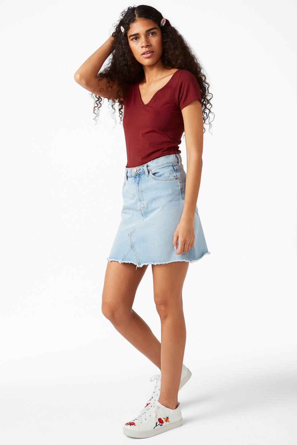 Model side image of Monki v-neck top in red