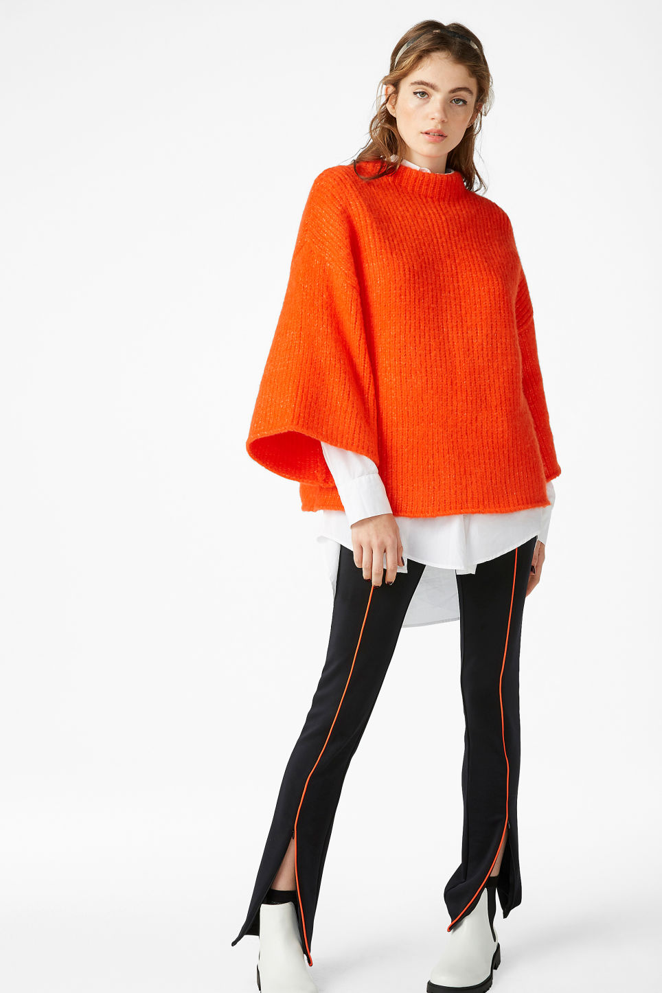 Model front image of Monki bell sleeve knit sweater in orange