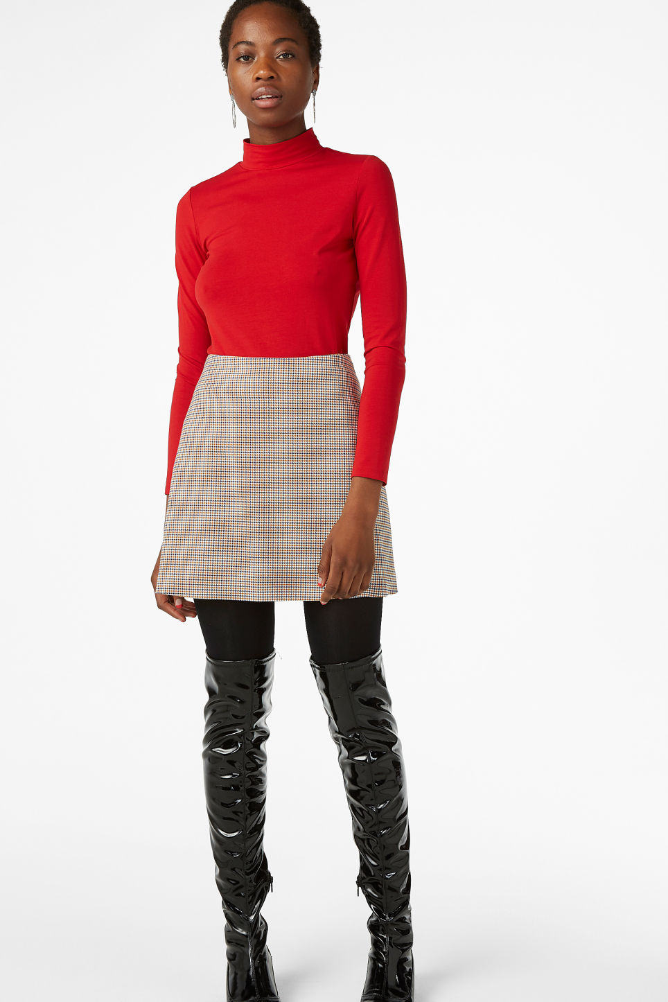 Model front image of Monki stretch turtleneck top in red