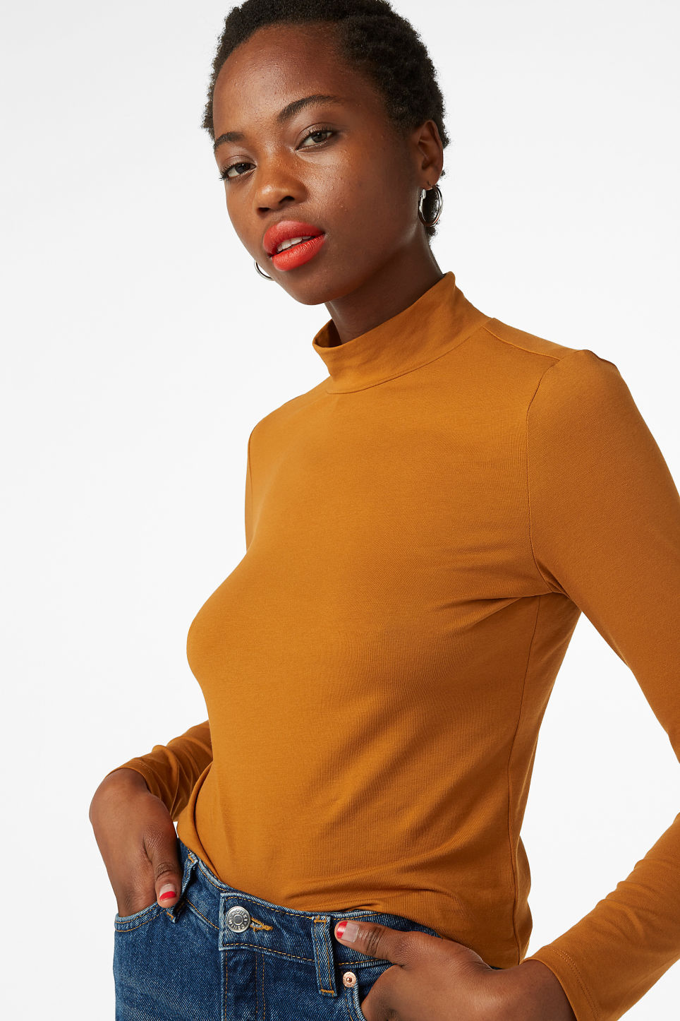 Model front image of Monki stretch turtleneck top in orange