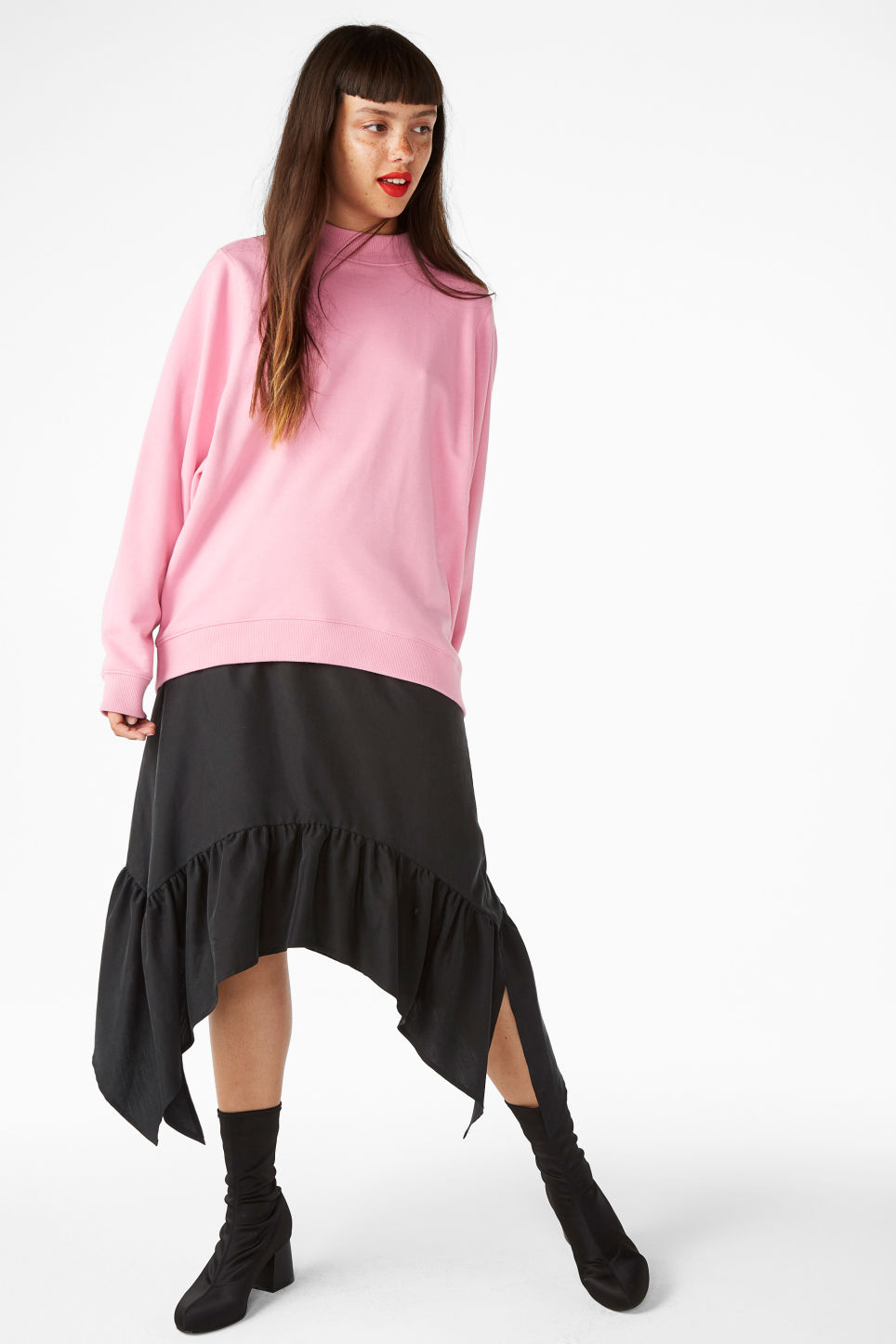 Model front image of Monki asymmetrical ruffle skirt in black