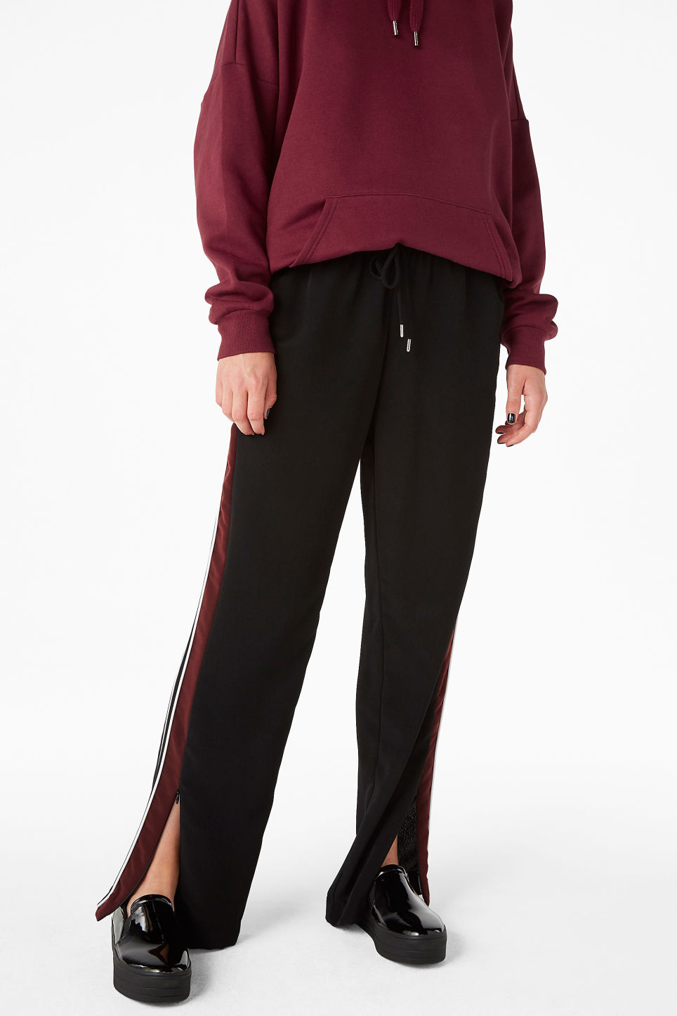 Model front image of Monki side stripe trousers in black