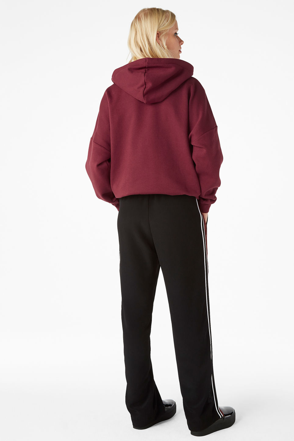 Model side image of Monki side stripe trousers in black
