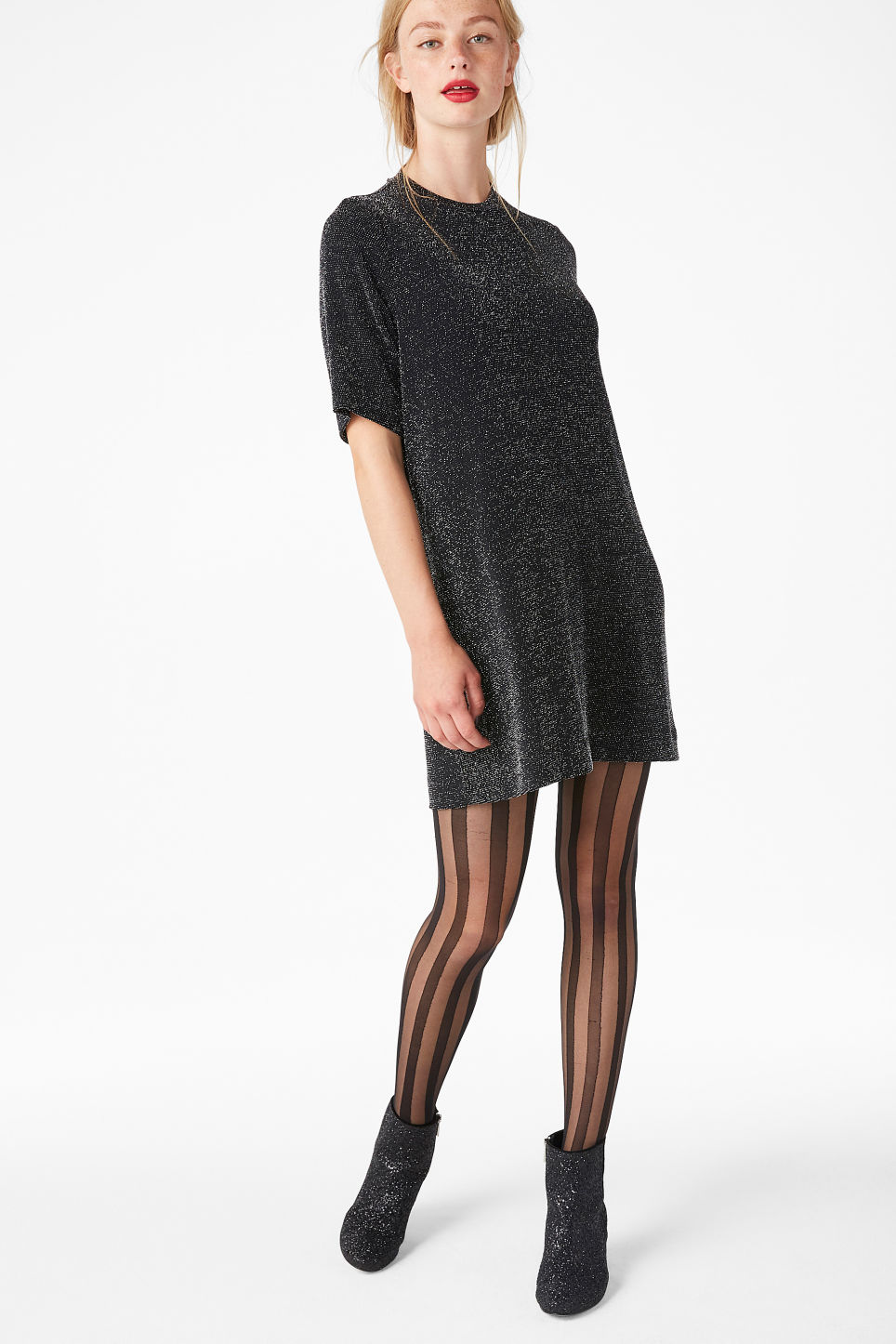 Model front image of Monki metallic t-shirt dress in black
