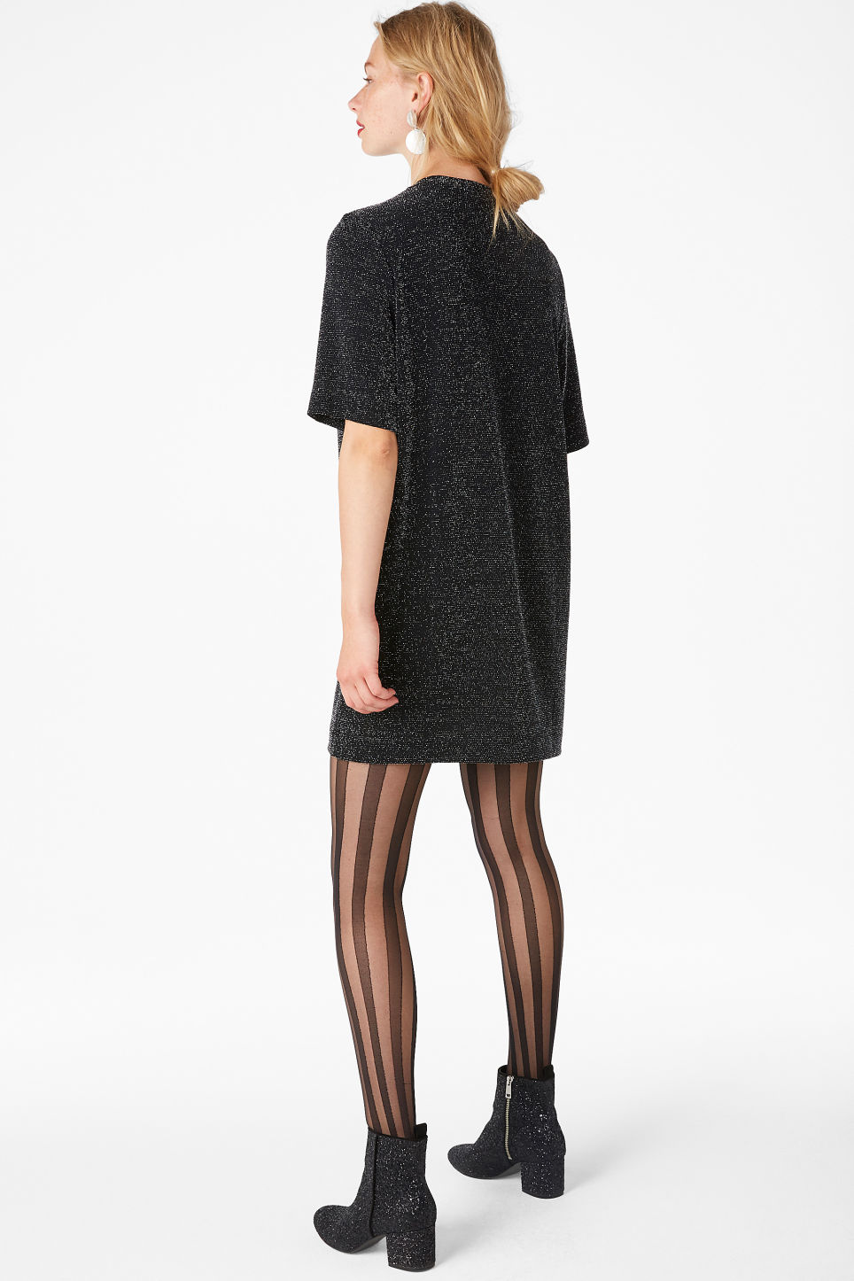 Model side image of Monki metallic t-shirt dress in black