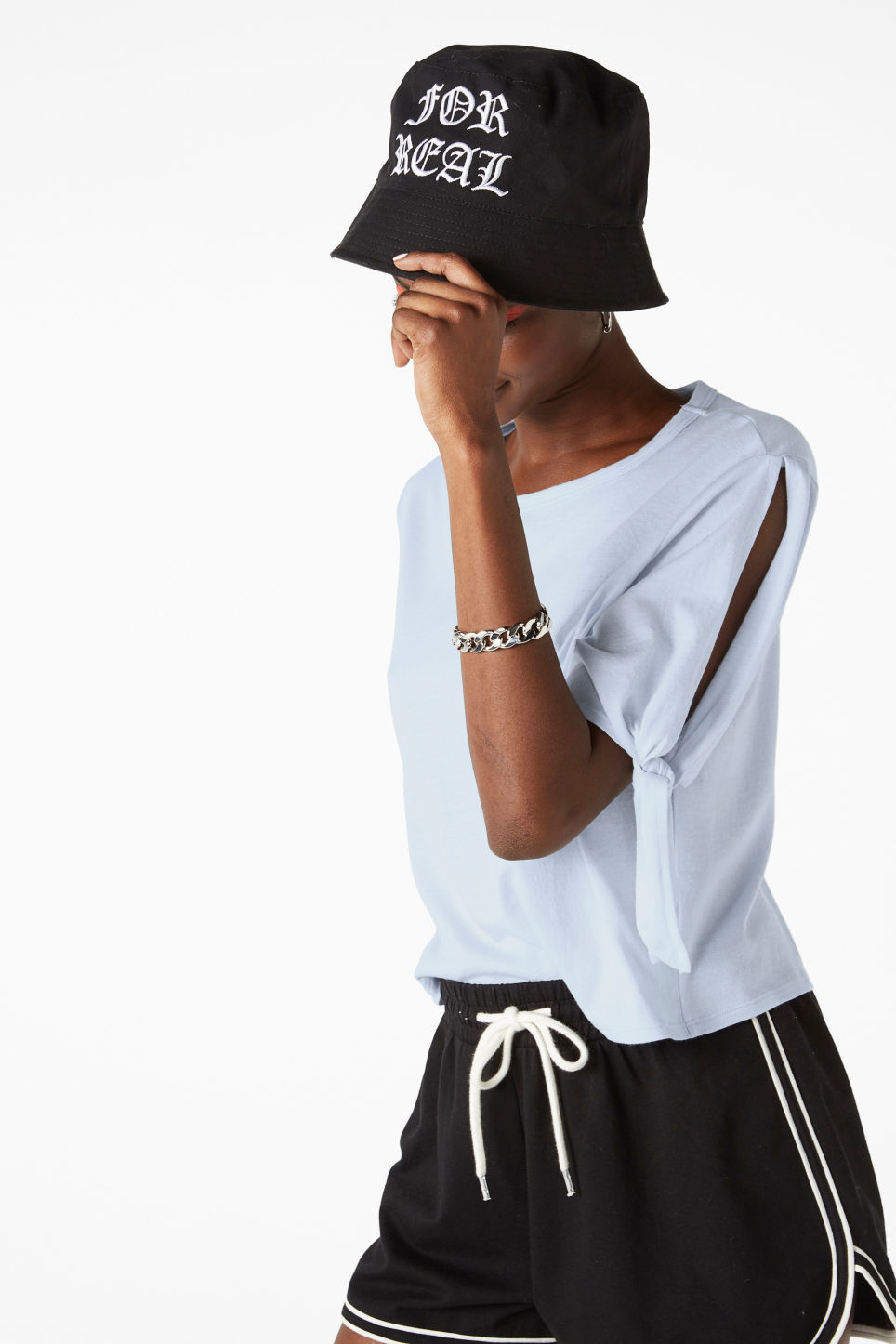 Model side image of Monki cropped tee with knot detail in blue