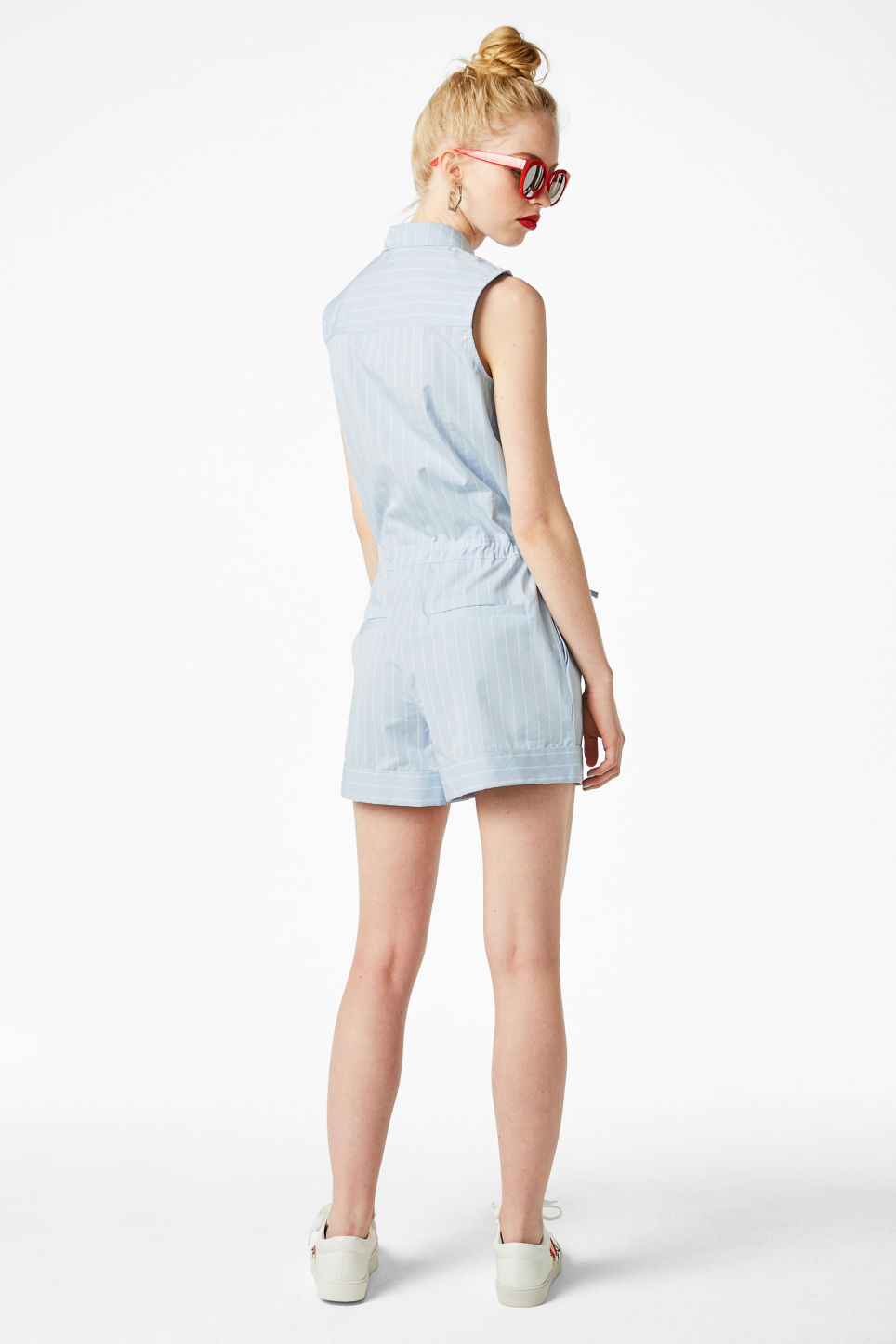 Model side image of Monki sleeveless playsuit in blue