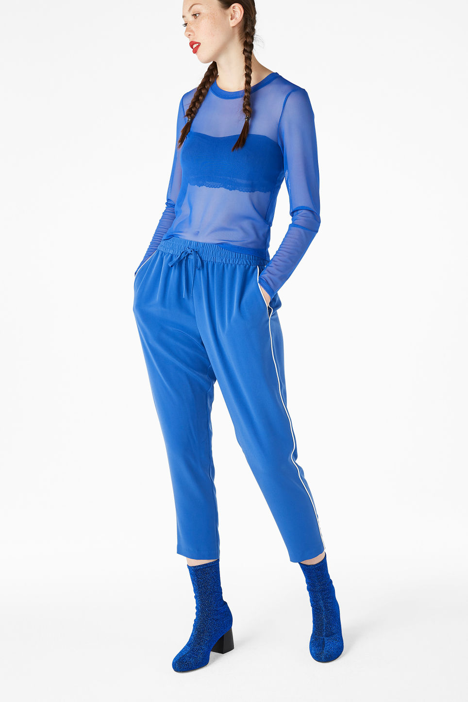 Model side image of Monki mesh cropped top in blue
