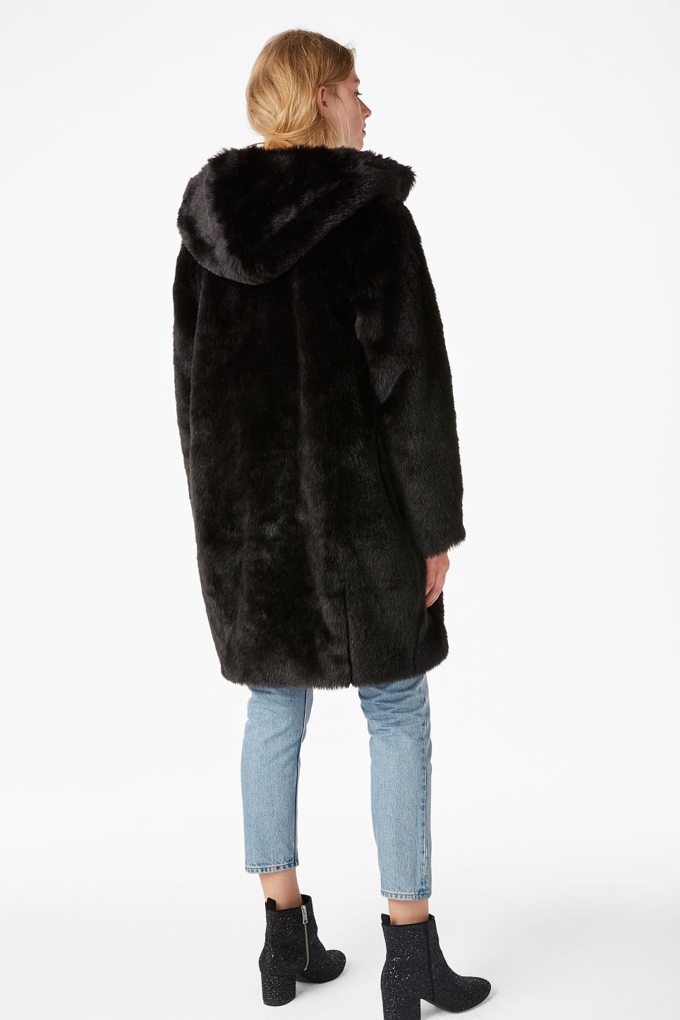 Model back image of Monki hooded faux fur coat in black