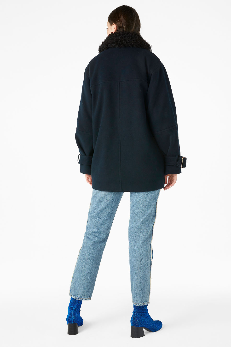Model back image of Monki coat with faux shearling collar in black