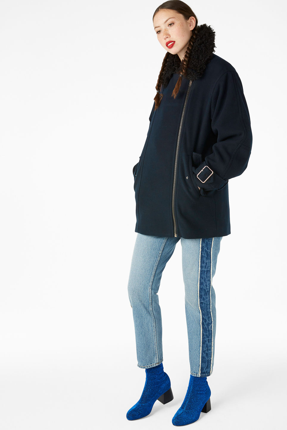 Model side image of Monki coat with faux shearling collar in black