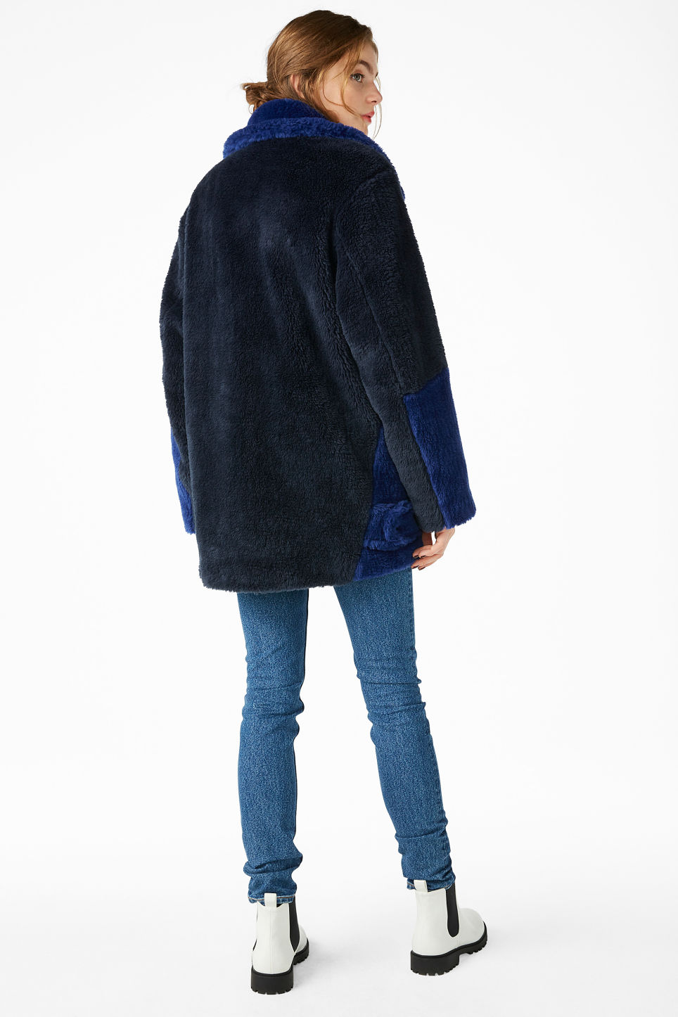 Model back image of Monki faux fur jacket in blue