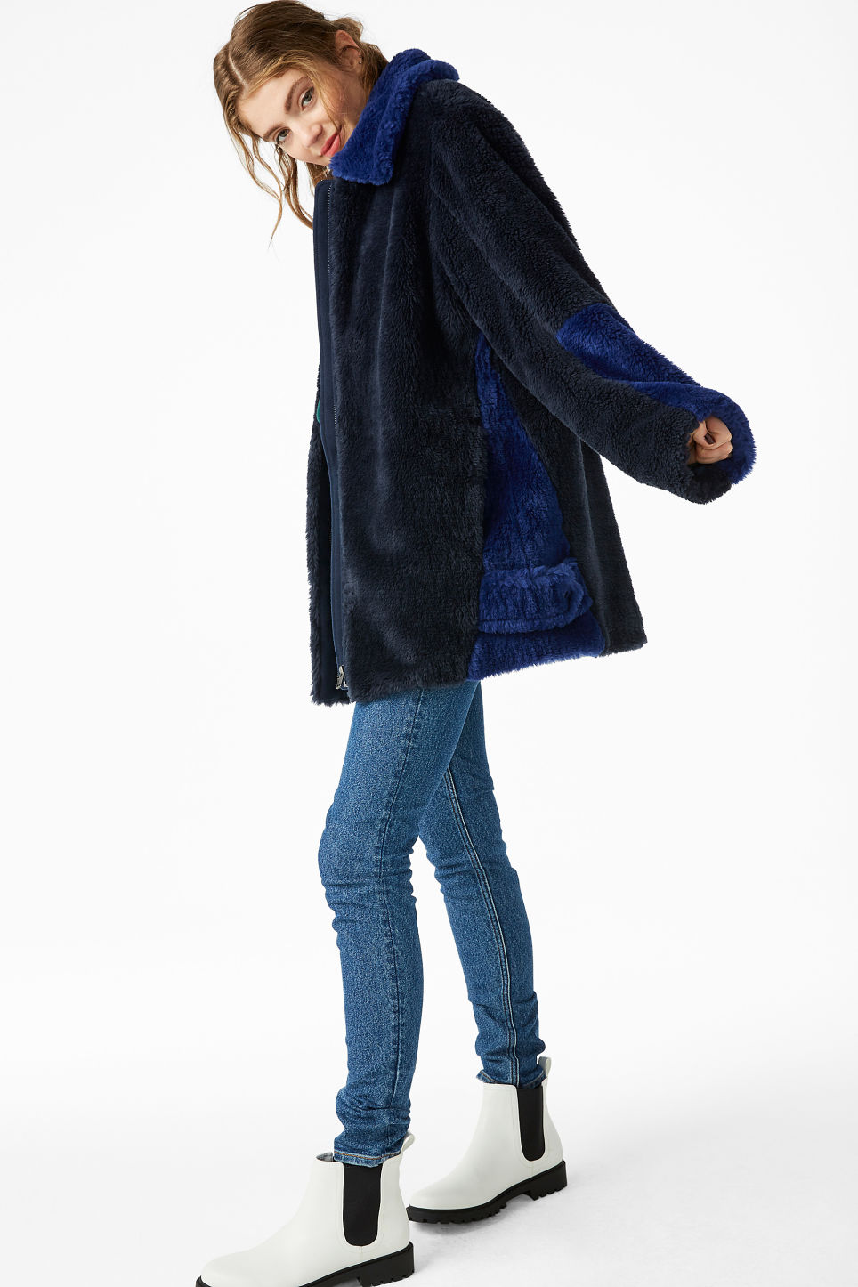 Model side image of Monki faux fur jacket in blue