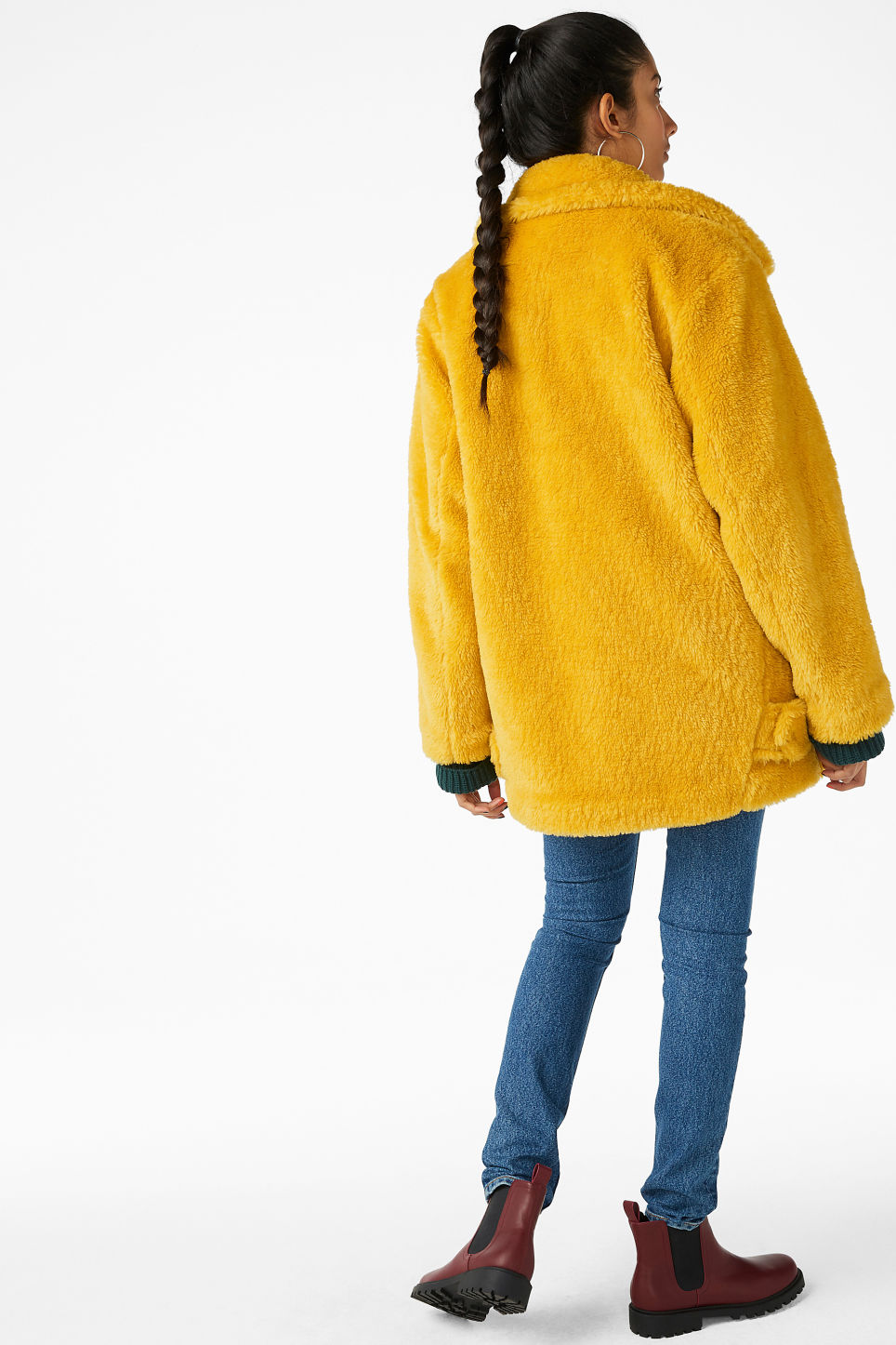 Model back image of Monki faux fur jacket in yellow