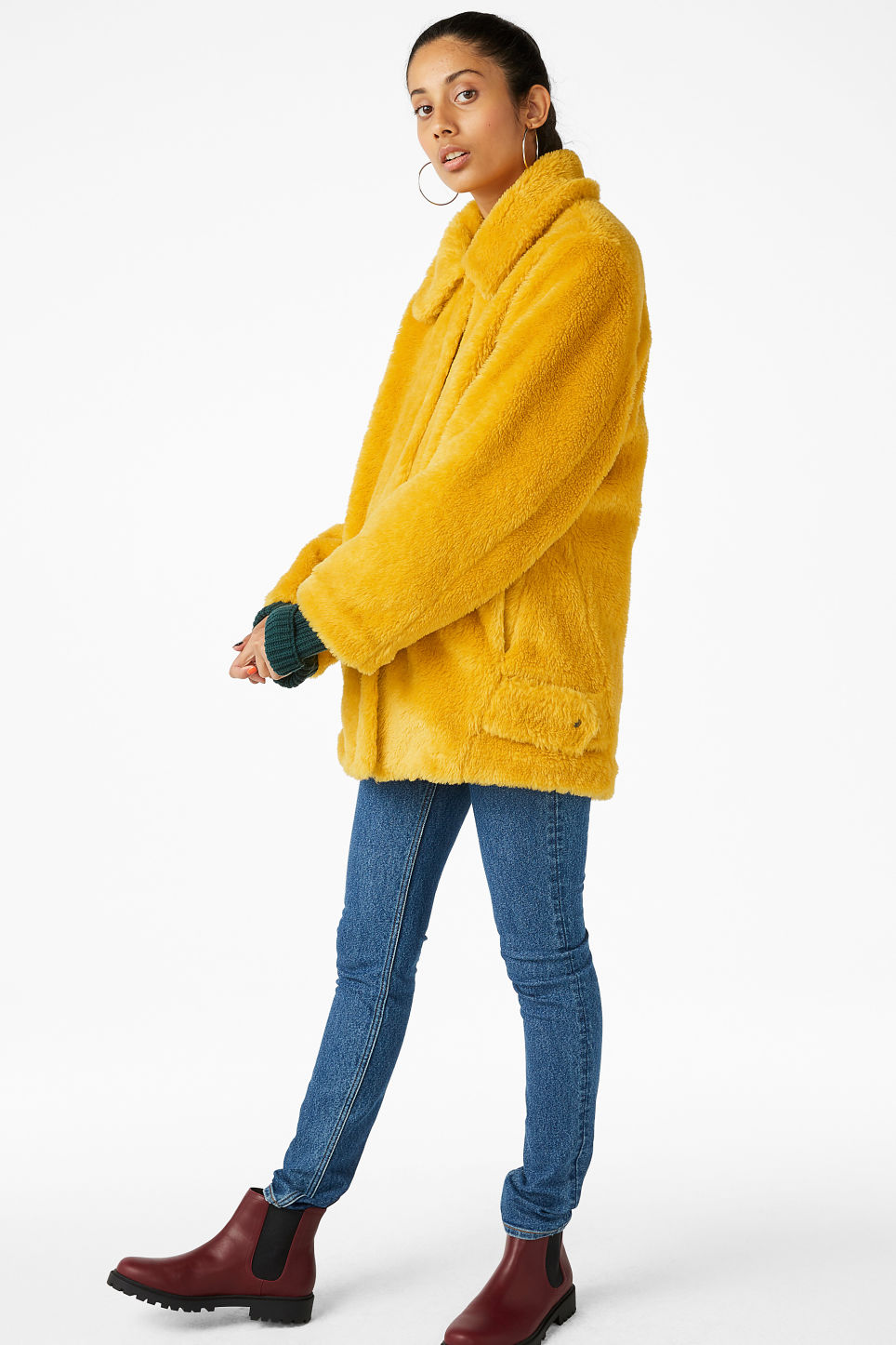 Model side image of Monki faux fur jacket in yellow